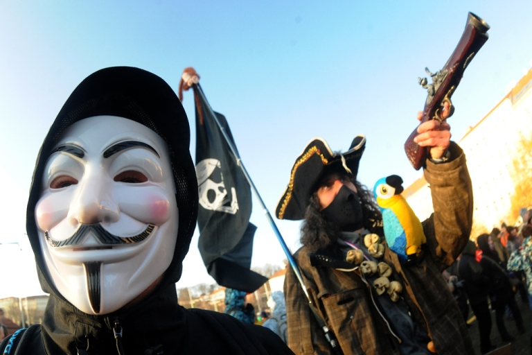 <p>A protestor wears a Guy Fawkes mask and one dressed as a pirate take part in a demonstration to protest against the Czech Republic government's plan to ratify the Anti-Counterfeiting Trade Agreement (ACTA)  on  February 2, 2012 in Prague.    AFP PHOTO/ MICHAL CIZEK</p>
