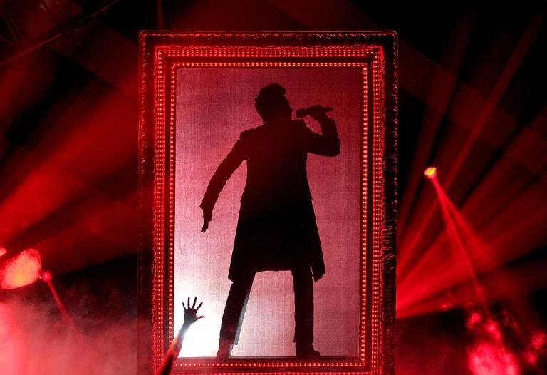 <p>Adam Lambert, onstage during