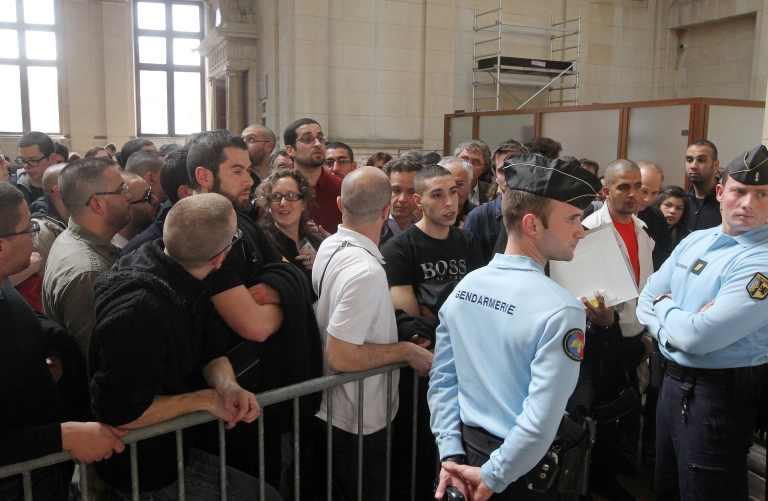 <p>People wait to attend the trial of Franco-Algerian physicist Adlene Hicheur, who formerly worked for CERN (European Centre for Nuclear Research) in Switzerland, on March 29, 2012 in Paris.</p>