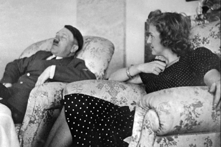 <p>Adolf Hitler relaxes with his mistress Eva Braun in this undated file photo.</p>
