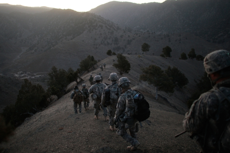 <p>Soldiers in the 1/501st of the 25th Infantry Division file off the ridge of a mountain where they spent the night in a Taliban stronghold area.</p>