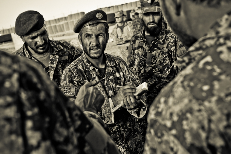 <p>Afghan soldiers in Maiwand District discuss battle plans at FOB Ramrod. Oct. 22, 2010.</p>