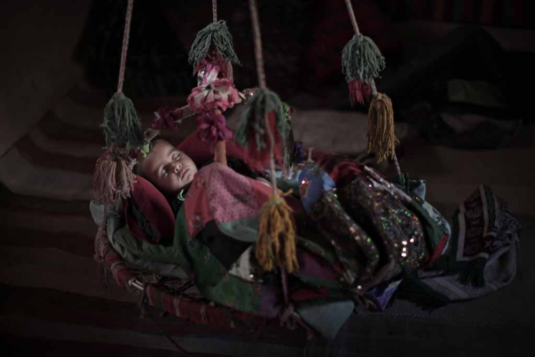 <p>An Afghan baby sleeps.</p>