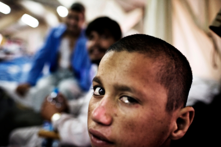 <p>Injured Afghan child Mohamed Gul, 12, is seen as he recovers in his hospital bed at the ward 1 on June 8, 2007 at the British Army Field Hospital at Camp Bastion in a location in the desert in the Helmand Province in southern Afghanistan.</p>