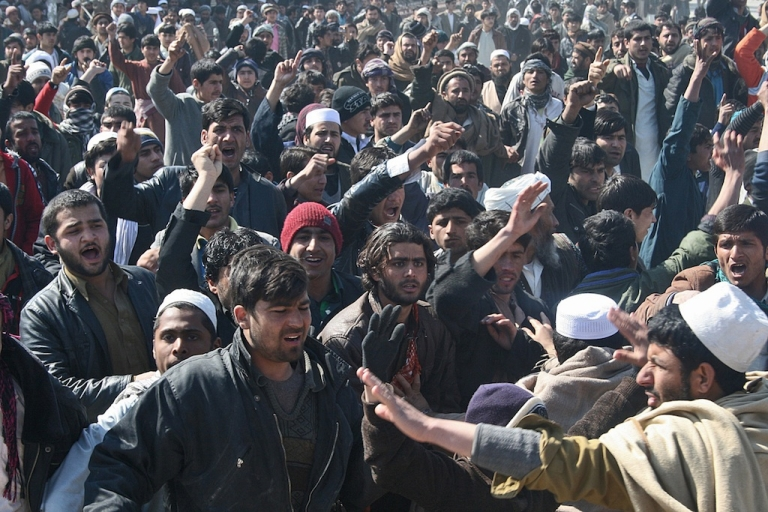 <p>Afghan demonstrators shout anti US-slogans during a protest against Koran desecration in Kunduz on February 25, 2012. Rock-throwing protesters attacked a UN compound and clashed with police in northern Afghanistan February 25, as a fifth day of protests over the burning of Korans left at least three dead. Thousands attacked the complex in Kunduz but did not get in as violence flared across the city, in unrest that raised to 27 the death toll from protests at Koran burning by troops from the US-led NATO force, according to an AFP tally.</p>