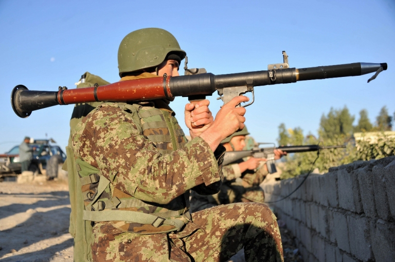 <p>Afghan National Army (ANA) soldiers take up positions behind a stone wall Dec. 18, 2012 in Jalalabad, Afghanistan. The ANA has its job cut out for it in the coming year as US troops withdraw.</p>