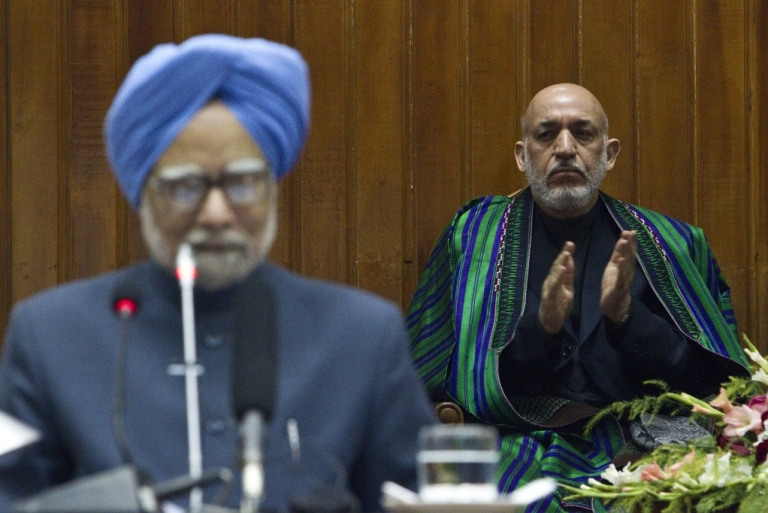<p>India's Prime Minister Manmohan Singh speaks at a session of the Afghan parliament in Kabul on May 13, 2011 as Afghan President Hamid Karzai watches.</p>