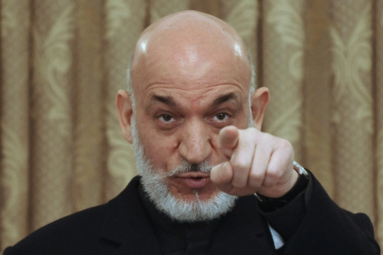 <p>Afghan President Hamid Karzai talks during a press conference at the Presidential Palace in Kabul on Apirl 11, 2011.</p>
