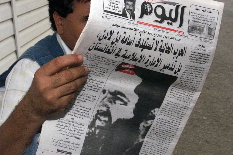<p>There is considerable speculation that Afghanistan Taliban leader Mullah Omar has been killed. Here, a man reads a newspaper with a photo of Omar on the front page. The newspaper is the Algerian daily El Youm from October 28, 2001.</p>