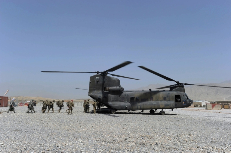 <p>US soldiers board a military helicopter after a ceremony to hand over security in Mehtar Lam, Laghman province on July 19, 2011.</p>