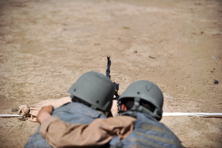 <p>Afghanistan Uniformed Policemen (AUP) fire a Kalashnikov during a shooting lesson with US Marines at Camp Leatherneck in Helmand province on June 2, 2012.</p>