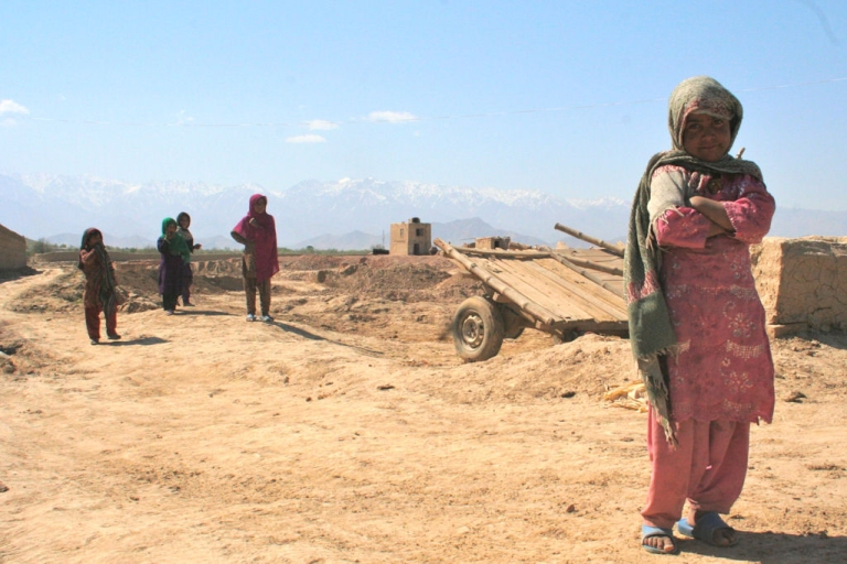 <p>Human rights groups say hundreds of women in Afghan jails are victims of rape or domestic violence. This Afghan girl is pictured near the mud-brick home her family built on the outskirts of Kabul, Afghanistan, in April 2011.</p>