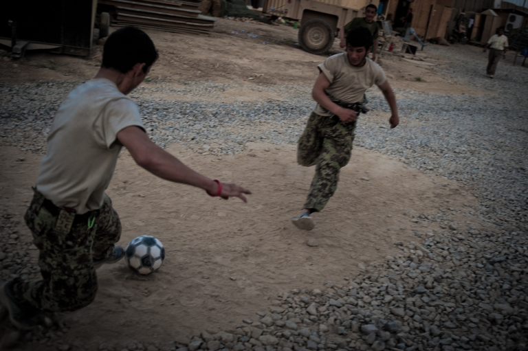<p>Afghan army soldiers play soccer on an American military base in Kandahar.</p>