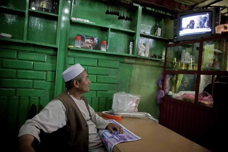 <p>Afghans watch television coverage announcing the killing of Osama bin Laden at a restaurant on May 2, 2011, in Kabul, Afghanistan.</p>