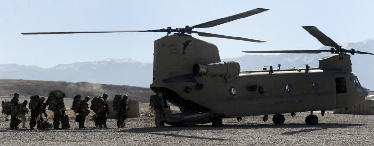 <p>Soldiers of the NATO/ISAF joint task force prepare to board an US Airforce Chinook helicopter from the Tarin Kowt military airbase at Tarin Kowt on January 19, 2010. The Netherlands Royal Army leads the NATO/ISAF joint task force in the southern province of Afghanistan. About 113,000 foreign troops under US and NATO command are based in Afghanistan, with about 40,000 more due to be deployed this year to try to turn around the costly war against the resurgent Taliban. DESHAKALYAN CHOWDHURY/AFP/Getty Images</p>