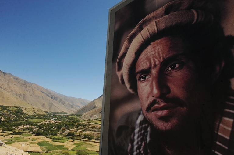 <p>A portrait of national hero Ahmad Shah Massoud, the Northern Alliance leader who fought the Soviet Union and the Taliban, overlooks his grave site in Afghanistan.</p>
