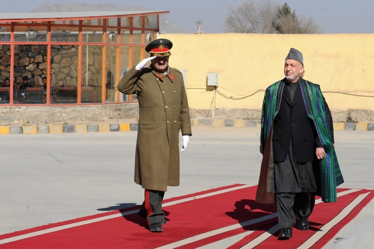 <p>Afghan President Hamid Karzai inspects a guard of honor before inaugurating the new parliament in Kabul on Jan. 26, 2011.</p>