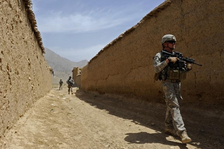 <p>U.S. soldiers in Zabul, Afghanistan walk to meet with village elders on May 27, 2011.</p>