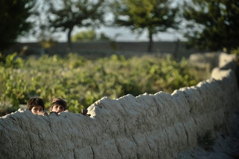 <p>Two Afghan children watch US military soldiers from the 3rd platoon, C-company, 1-23 infantry on patrol in Genrandai village at Panjwai district, Kandahar on September 24, 2012. The Afghan Taliban dismissed NATO figures showing a decrease in insurgent attacks, saying the statistics reflect troop withdrawals and a 'cowardly' avoidance of contact.</p>