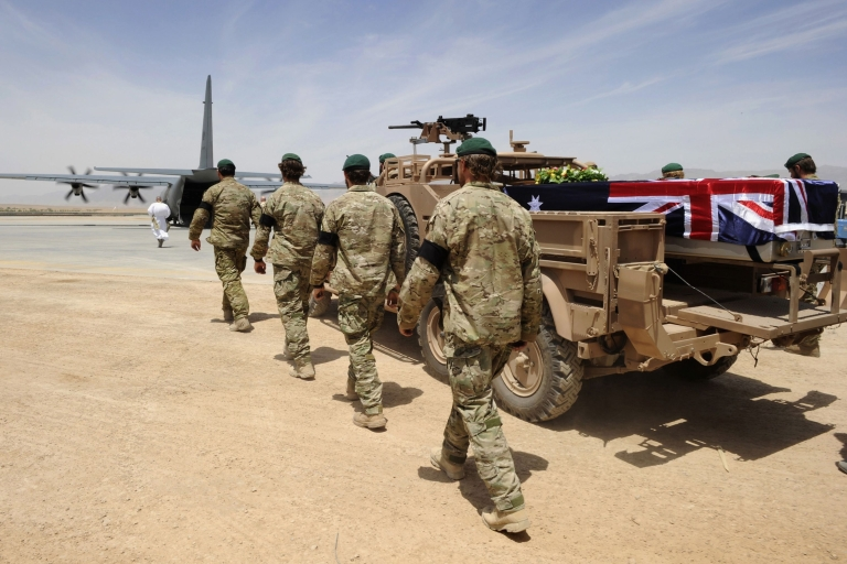 <p>In this photo provided by ISAF Regional Command (South), a special forces bearer party walks alongside the casket of Sergeant Brett Wood to a C-130 aircraft at Tarin Kot Airfield, Saturday, May 28, 2011, in Uruzgan, Afghanistan. Wood was killed in action during a partnered Special Operations Task Group and Afghan National Police mission.</p>