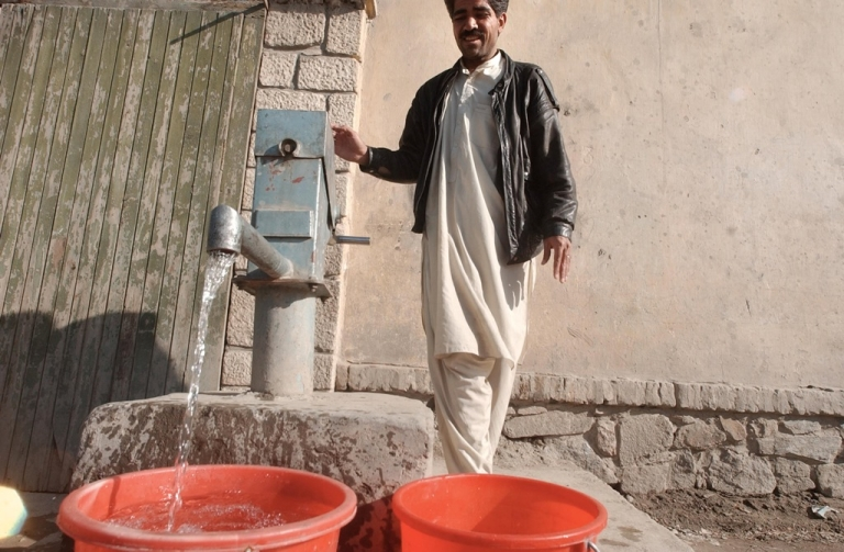 <p>An Afghan man pumps water from a well March 11, 2003 in Kabul, Afghanistan. A six-year drought has dried up dams and forced workers to drill wells and hand dig tunnels in efforts to bring water into the cities.</p>