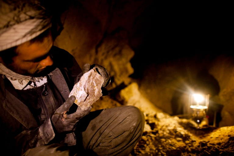 <p>An Afghan miner works in a makeshift emerald mine in The Panjshir Valley in July, 2010. Reports sugest that Afghanistan is sitting on significant deposits of oil, gas, Copper, iron, gold and coal as well as a range of precious gems like emeralds and rubies. Currently these minerals are largely untapped.</p>