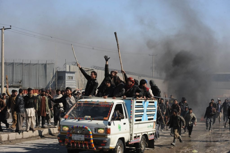 <p>Afghans protest the burnings of the Muslim holy book at a NATO base during a demonstration in Kabul on February 22.</p>