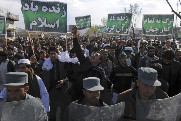 <p>Afghan riot police lead a march as Afghan protesters shout slogans against the US, Israel, and England during a demonstration in Kabul on April 1, 2011. A number of people went on demonstration in Kabul on April 1 in protest to the burning of a Koran by a US evangelical preacher in Florida in mid-March.</p>