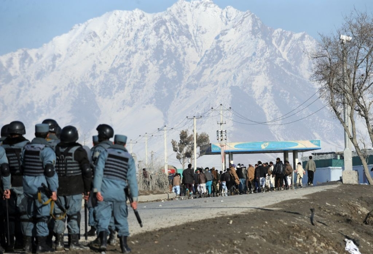<p>Afghan policemen stand alert during a protest against Quran desecration in Kabul on Feb. 24, 2012.</p>