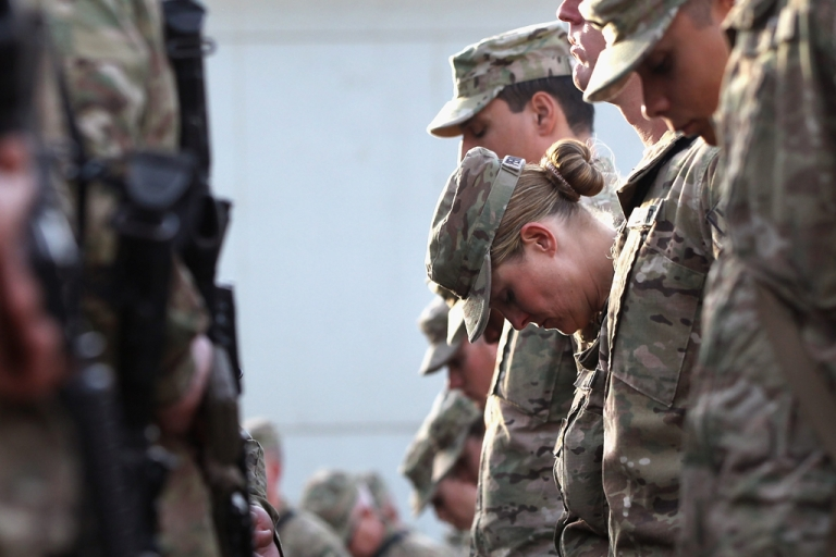 <p>US soldiers pray during the an anniversary ceremony of the terrorist attacks on September 11, 2001 on September 11, 2011 at Bagram Air Field, Afghanistan. Ten years after the 9/11 attacks in the United States and after almost a decade war in Afghanistan, American soldiers paid their respects in a solemn observance of the tragic day.</p>