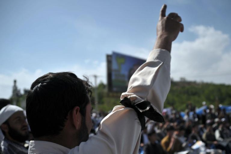 <p>An Afghan demonstrator gestures during a protest against the US and the government of Afghanistan in Kabul on May 18, 2012. Hundreds of Afghans, most of them clerics, rallied in Kabul to protest the signing of an agreement that would allow US troops to remain in the country after the planned transfer of authority in 2014.</p>