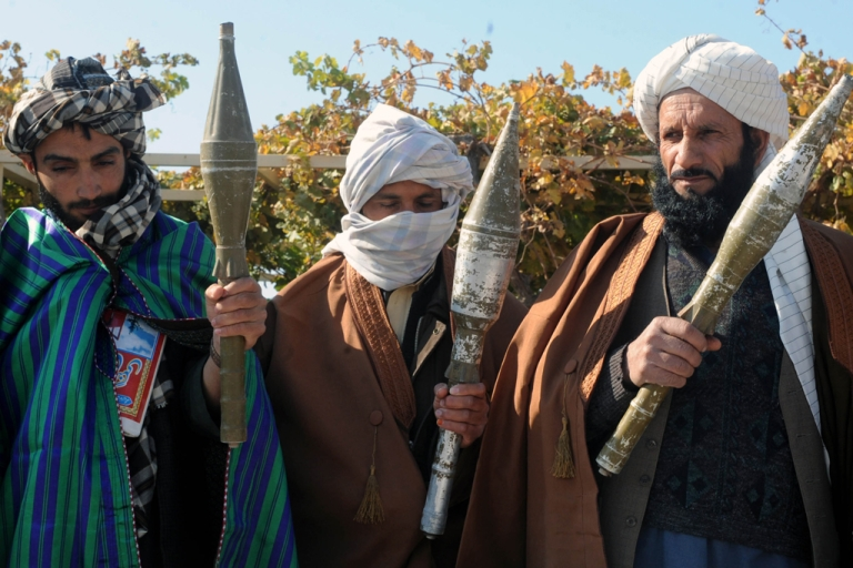 <p>Former Taliban fighters display their weapons after they joined Afghan government forces during a ceremony in Herat on November 3, 2012.</p>
