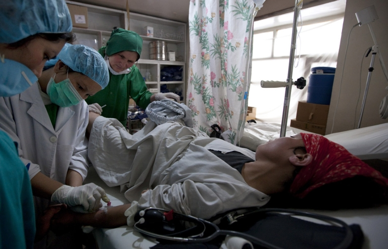 <p>Afghan midwife students work on a pregnant woman in labor who is having complications in the delivery room at the Bamiyan Provincial hospital in Bamiyan, Afghanistan. The 18 month midwife program was funded by USAID.</p>