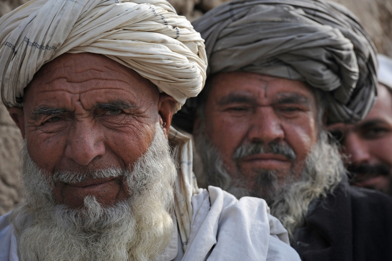 <p>Afghan men wait to receive winter supplies at a UNHCR distribution center for needy refugees on the outskirts of Kabul on Dec 27. The head of the United Nations refugee program in Afghanistan described its strategy in the war-wracked country as the 'biggest mistake UNHCR ever made.'</p>
