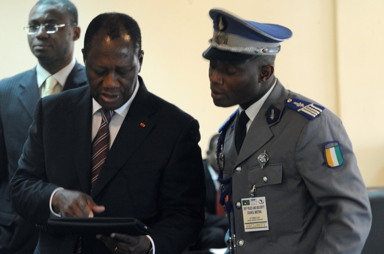 <p>Ivory Coast's internationally recognized President Alassane Ouattara (L) uses an iPad on Mar. 10, 2011 prior to attending African Union talks in Addis Ababa.</p>