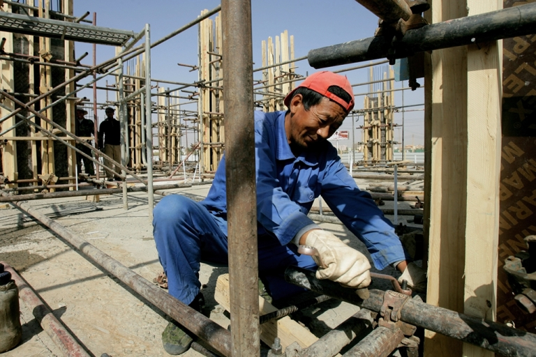 <p>A Chinese worker fixes pipes at a construction site in the capital Khartoum. China has emerged as a major funder of infrastructure projects throughout Africa, pledging $20 billion in investment over the next three years.</p>