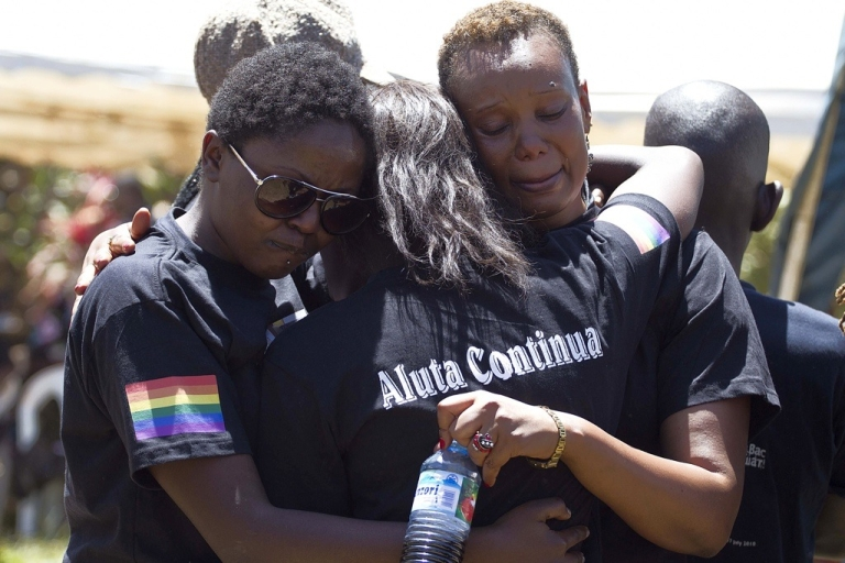 <p>Members of the Ugandan gay community mourn at the funeral of murdered activist David Kato near Mataba, on January 28, 2011. Although the police claim it was most likely a petty crime, many members of the gay and the human rights community hold the Ugandan government responsible for not battling the growing violence against homosexuals in the Ugandan society.</p>