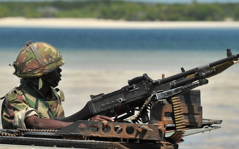 <p>Kenyan soldiers are engaged in an ongoing war with Somalia's Al Shabaab. Here, a Kenyan Defence Force soldier keeps lookout on the coast near Burgabo village, Southern Somalia on December 14, 2011.</p>