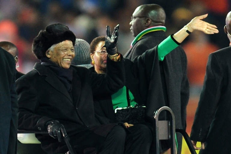 <p>A new miniseries is being produced to tell the story of Nelson Mandela's life. Here, Mandela and wife Graca Machel wave to the crowds prior to the 2010 FIFA World Cup South Africa Final match between Netherlands and Spain at Soccer City Stadium on July 11, 2010 in Johannesburg, South Africa.</p>
