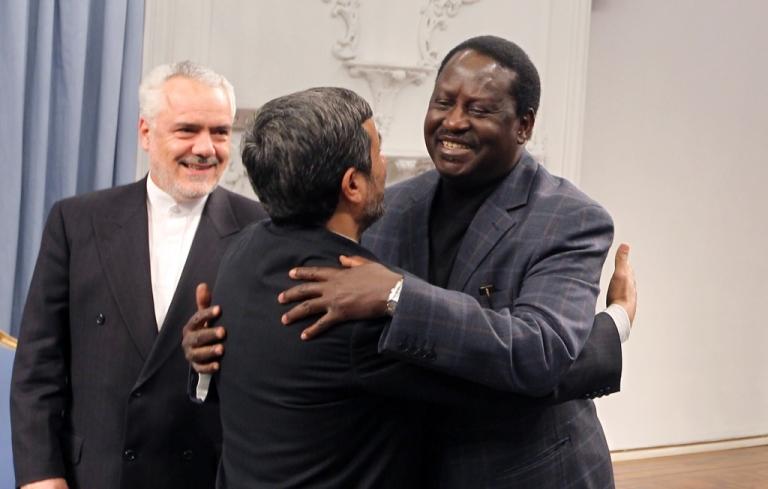 <p>Iran's President Mahmoud Ahmadinejad (C) hugs with Kenyan Prime Minister Raila Odinga (R) as Iran's first vice-president Mohammad Reza Rahimi (L) looks on prior to a meetings in Tehran on March 6, 2011.</p>