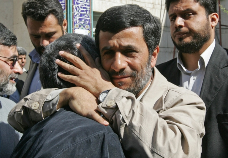 <p>Iranian President Mahmoud Ahmadinejad hugs a supporter upon arriving to cast his ballot inside a polling station in Tehran during the second round of parliamentary elections on April 25, 2008. Iranians started voting today in the second round of legislative elections expected to tighten the conservatives' grip on parliament after reformists were hurt by pre-poll disqualifications.</p>