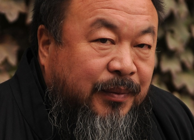 <p>Chinese artist Ai Weiwei sits in the courtyard of his home in Beijing on November 7, 2010.</p>