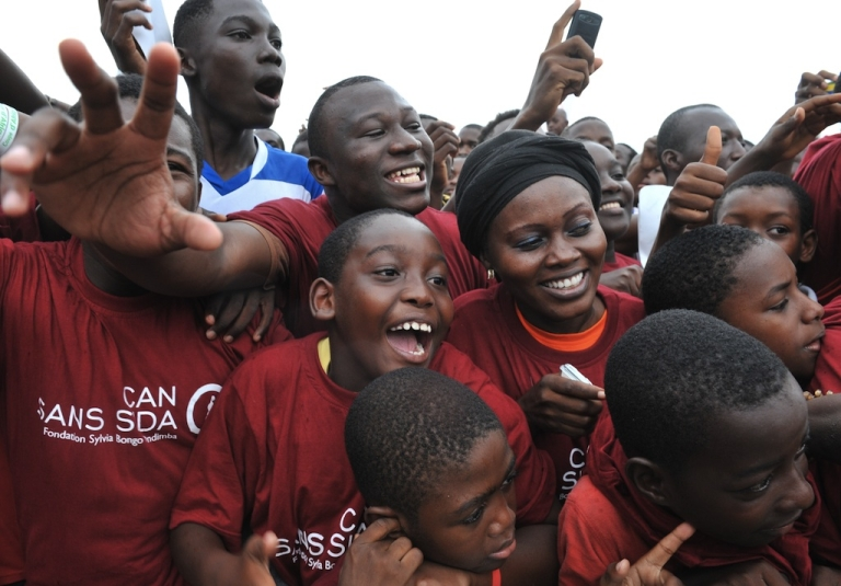 <p>Crowds cheer during an AIDS awareness campaign in Libreville, Gabon, on February 10, 2012 during the Africa Cup of nations soccer tournament.</p>