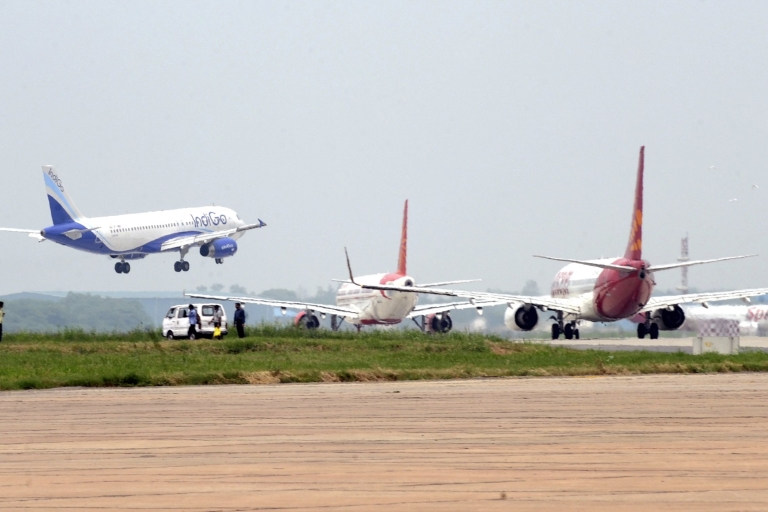 <p>Aircraft from Indigo (L), Air India (C) and Spicejet (R) jostle for space on a runway at Indira Gandhi International Airport in New Delhi on July 13, 2011.</p>