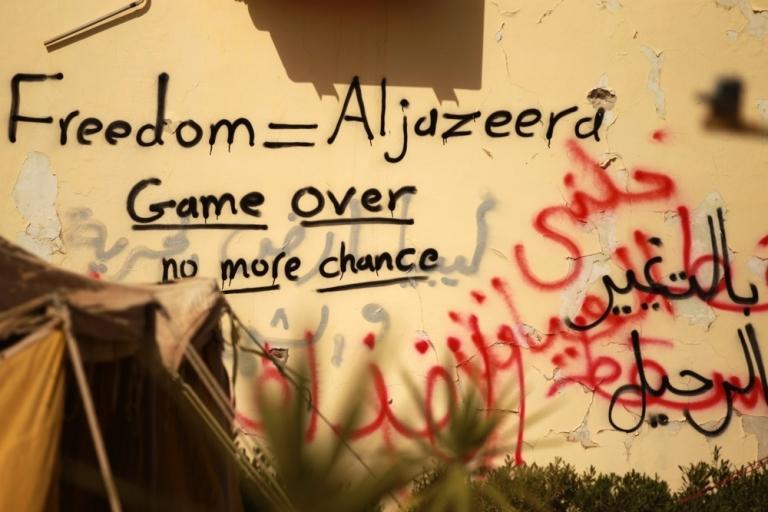 <p>Graffiti praising Al-Jazeera news channel is seen on a wall in the eastern dissident-held Libyan city of Tobruk on Feb 24, 2011.</p>