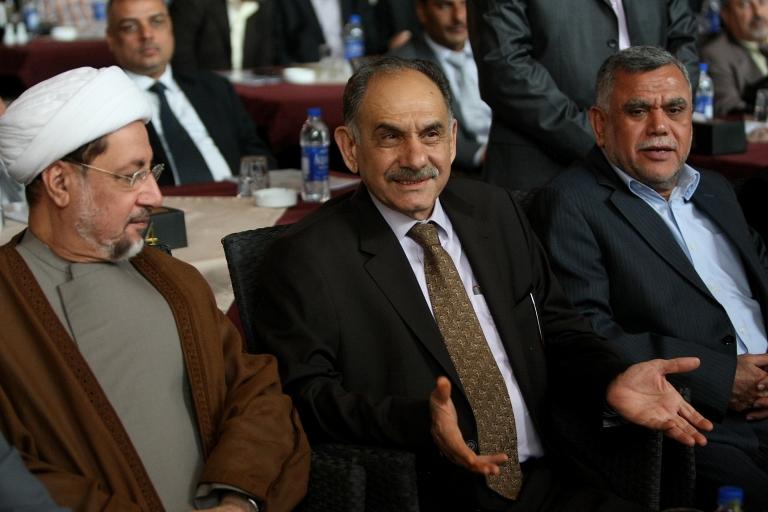 <p>Deputy Prime Minister Saleh al-Mutlaq (center), with Iraqi deputy Khaled al-Attiyah (L) and Transportation Minister Hadi al-Amiri (R), at a press conference in Baghdad on July 6, 2011.</p>