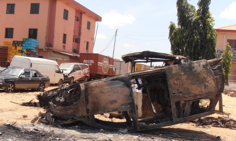 <p>A car lies upside-down, vandalized on June 17 by Christian mobs in reprisal for a suicide bomb attack. Nigeria's Boko Haram Islamists claimed responsibility for suicide attacks on three churches that sparked reprisals by Christian mobs who rampaged and burned mosques, killing least 52 people.</p>