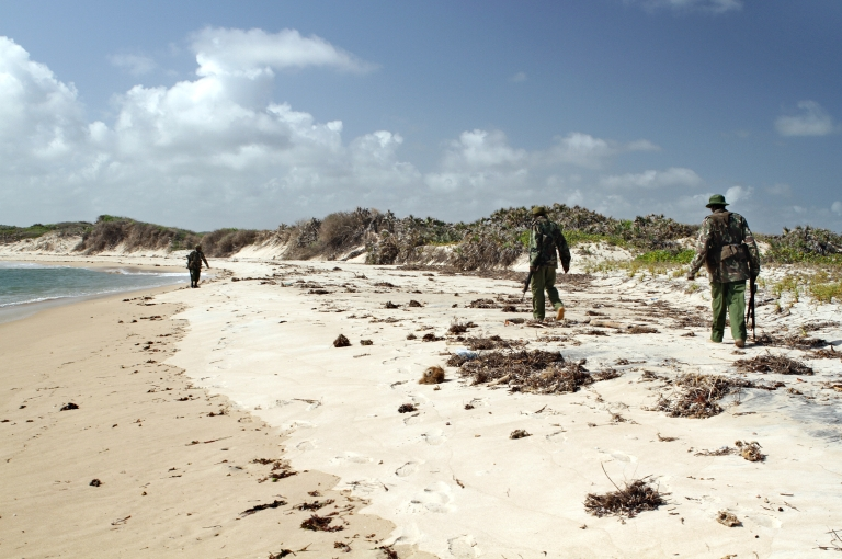 <p>Armed policemen patrol a stretch of beach near Kiwayu Safari village in Kenya on Sept. 12, 2011. Holidaying British couple David and Judith Tebbutt were attacked there on Sept. 11, 2011, by suspected Somalia based Al-Shabab militia, ending in the fatal shooting of David. Judith Tebbutt was held in Somalia for six months, before being released and flown to Nairobi on March 21, 2012.</p>