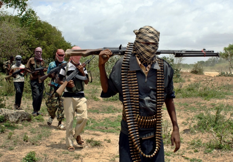 <p>Somali hardline islamists walk past at a training camp on the outskirts of Afgoye district in Somalia's lower Shabelle region October 20, 2009.</p>