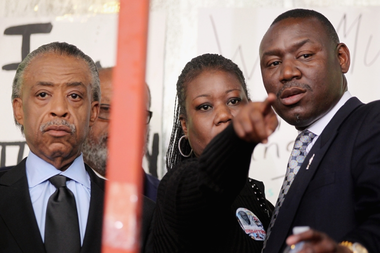 <p>Rev. Al Sharpton (L) attends a rally with Sybrina Fulton (C), mother of slain teenager Trayvon Martin, as family attorney Benjamin Crump (R) looks on March 22, 2012 in Sanford, Florida. Sanford Police Department Chief Bill Lee announced he will temporarily step down following the killing of the black unarmed teenager by a white and Hispanic neighborhood watch captain. Sharpton organized the rally.</p>